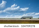 semi truck on the road... | Shutterstock . vector #104709278