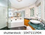 large bathroom interior with... | Shutterstock . vector #1047111904