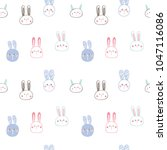 Stock vector seamless pattern of cute rabbit face design on white background 1047116086