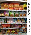 Small photo of Bangkok, Thailand - March 14, 2018: A shelf of ready-to-eat food products in 7-11, a famous convenient store with over 10,000 across the country.
