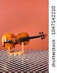 violin on a wooden stand on a... | Shutterstock . vector #1047142210