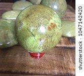 green opal crystal sphere on... | Shutterstock . vector #1047142420