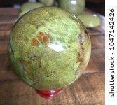 green opal crystal sphere on... | Shutterstock . vector #1047142426