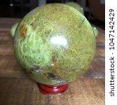 green opal crystal sphere on... | Shutterstock . vector #1047142429