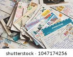 pile of written postcards in... | Shutterstock . vector #1047174256