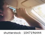 man taking health drink while... | Shutterstock . vector #1047196444