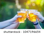 celebration beer cheers concept ... | Shutterstock . vector #1047196654
