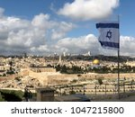 Small photo of Israel flag above the old city of Jerusalem Israel
