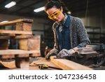 professional carpenter woman... | Shutterstock . vector #1047236458