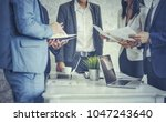 group of business people... | Shutterstock . vector #1047243640