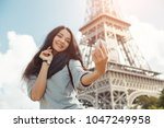 happy travel woman taking funny ... | Shutterstock . vector #1047249958
