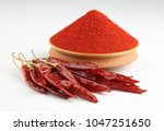 indian spice red chilli powder | Shutterstock . vector #1047251650