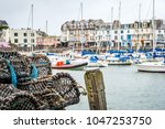 lobster pots sit on the...   Shutterstock . vector #1047253750