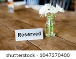 reserved metal plate on the... | Shutterstock . vector #1047270400