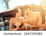 company of happy friends drinks ... | Shutterstock . vector #1047290389
