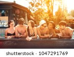 company of young people share... | Shutterstock . vector #1047291769