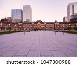 tokyo station and business... | Shutterstock . vector #1047300988