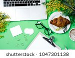 woman work space with laptop ...   Shutterstock . vector #1047301138