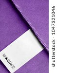 care clothes label on purple... | Shutterstock . vector #1047321046