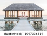 two in a bungalow at sunset | Shutterstock . vector #1047336514