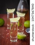Small photo of Tequila in shot glasses with lime and salt
