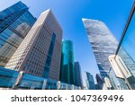 high rise building of shiodome. ... | Shutterstock . vector #1047369496