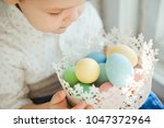 the little boy holds in his... | Shutterstock . vector #1047372964