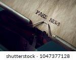 closeup of an old typewriter... | Shutterstock . vector #1047377128