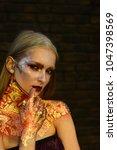 girl with blond hair  golden... | Shutterstock . vector #1047398569