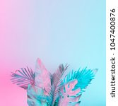 tropical and palm leaves in... | Shutterstock . vector #1047400876