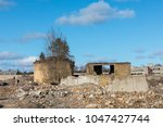 ruins on an old cellulose... | Shutterstock . vector #1047427744