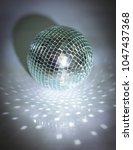 mirror ball.isolated on a dark... | Shutterstock . vector #1047437368