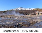 hot springs and geyser at... | Shutterstock . vector #1047439903