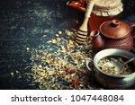 tea in a cup on a metallic... | Shutterstock . vector #1047448084