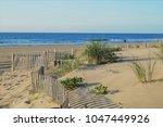 stone harbor dunes. a quiet... | Shutterstock . vector #1047449926