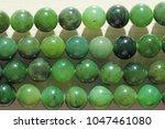 natural green jade nephrite... | Shutterstock . vector #1047461080