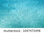 light blue vector background... | Shutterstock .eps vector #1047472498