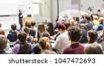 female speaker giving... | Shutterstock . vector #1047472693