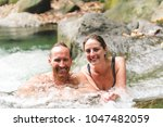 attractive couple under jungle...   Shutterstock . vector #1047482059