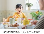 asian family having breakfast | Shutterstock . vector #1047485404