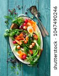 salad greens with egg  smoked... | Shutterstock . vector #1047490246