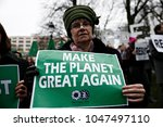 people hold placards and shout... | Shutterstock . vector #1047497110