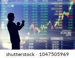 silhouette of investors are... | Shutterstock . vector #1047505969