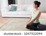 beautiful woman sitting in home ... | Shutterstock . vector #1047522094