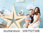 happiness and beautiful family | Shutterstock . vector #1047527188