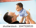 hapiness and beatiful family | Shutterstock . vector #1047528520
