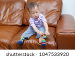 cute little asian 18 months old ... | Shutterstock . vector #1047533920
