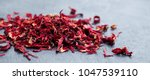 hibiscus flower tea scattered... | Shutterstock . vector #1047539110
