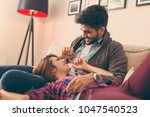 couple in love relaxing at home ... | Shutterstock . vector #1047540523