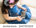 top view of little girl sitting ... | Shutterstock . vector #1047551023